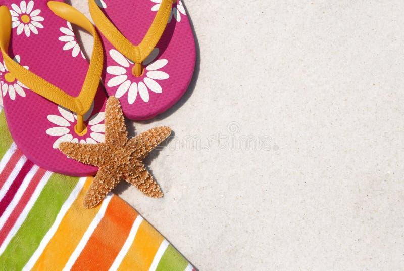 strandflipen plumsar handduken royaltyfria foton
