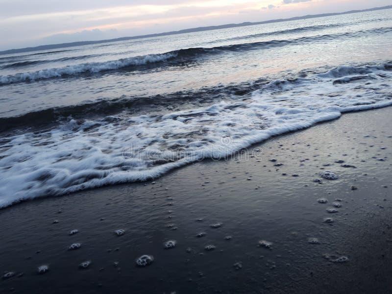 Strandgolven stock afbeeldingen