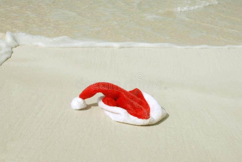 strandhatt s santa royaltyfri foto