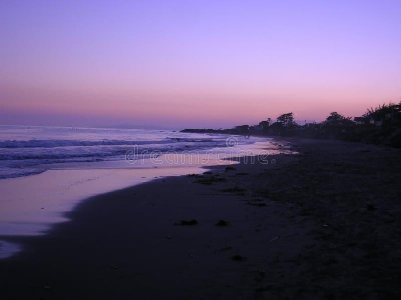 strandKalifornien solnedgång arkivfoto