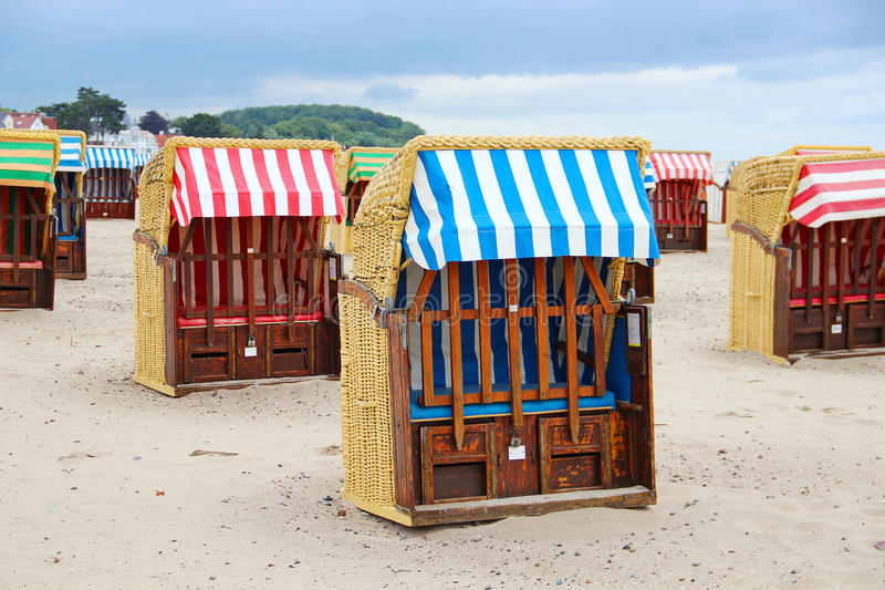 Strandkorb - typical beach chairs on the Baltic sea. Strandkorb typical Baltic sea beach chairs in Travemunde, Germany royalty free stock photo