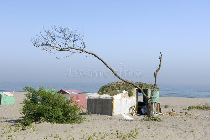 strandlägerpoor royaltyfria bilder
