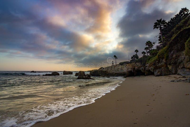 strandlaguna solnedgång royaltyfri bild