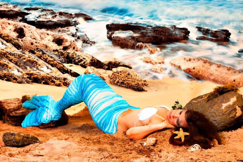 strandmermaid royaltyfria foton