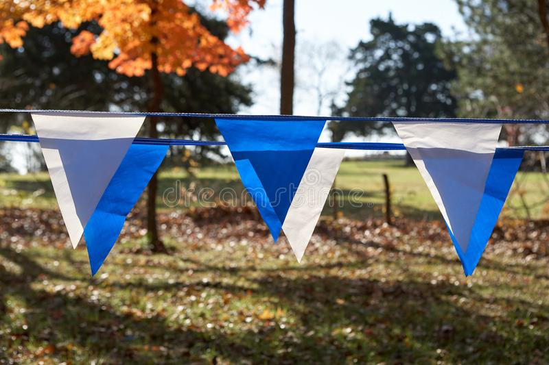 Strands of colorful blue and white bunting stock image