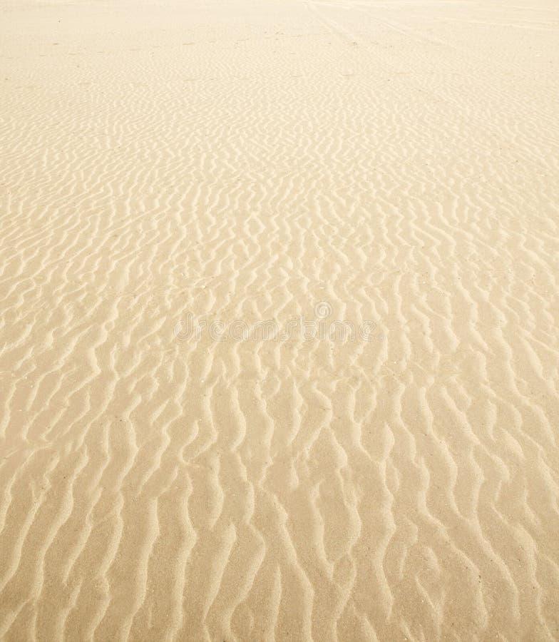 Strandsandwellen wärmen Beschaffenheitshintergrund stockfotos