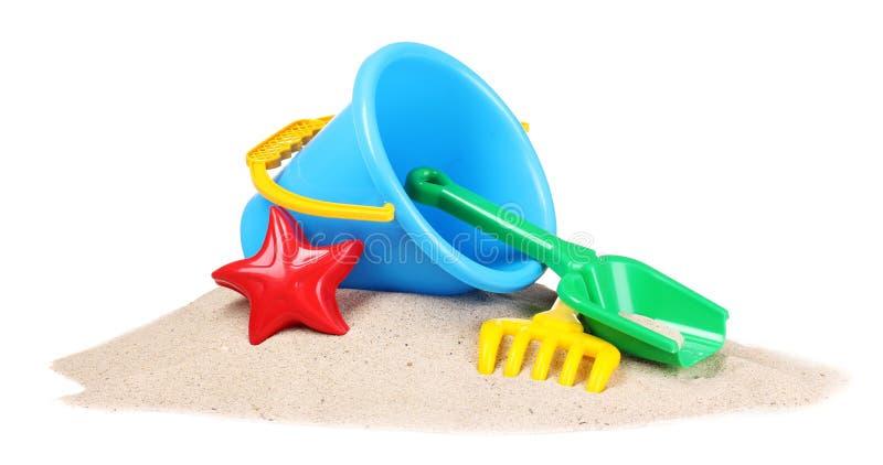 Strandspielwaren und -sand der Kinder lizenzfreie stockbilder
