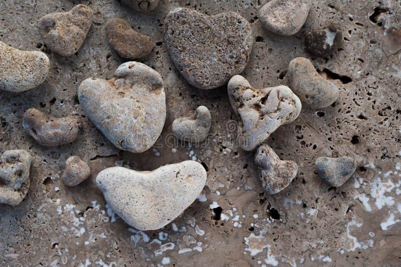 Strandstenhjärtor arkivfoto