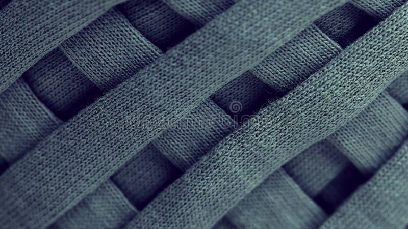 Strang der grauen gestrickten Garnnahaufnahme Makrophotographiehintergrund-Beschaffenheitsmuster spinnen Fasertextilgewebe Streif lizenzfreie stockfotografie