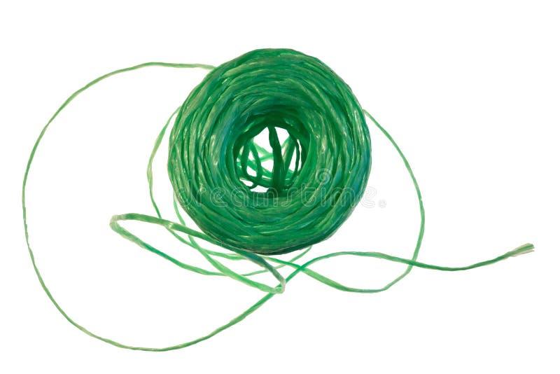 Strang des grünen Nylonfadens auf einem weißen Hintergrund stockfotos