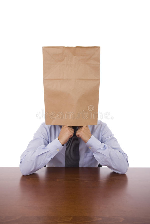 Strange. A business man with a cardboard bah on his head stock photos