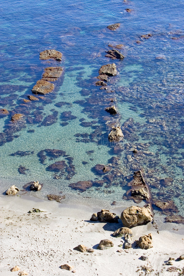 Strange, beautiful rock formations in shallow sea stock image