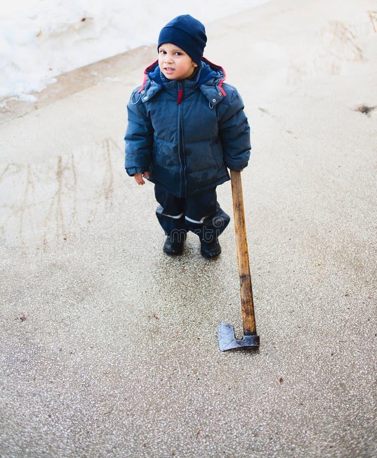 Download Strange child holding axe stock image. Image of outdoors - 23331309