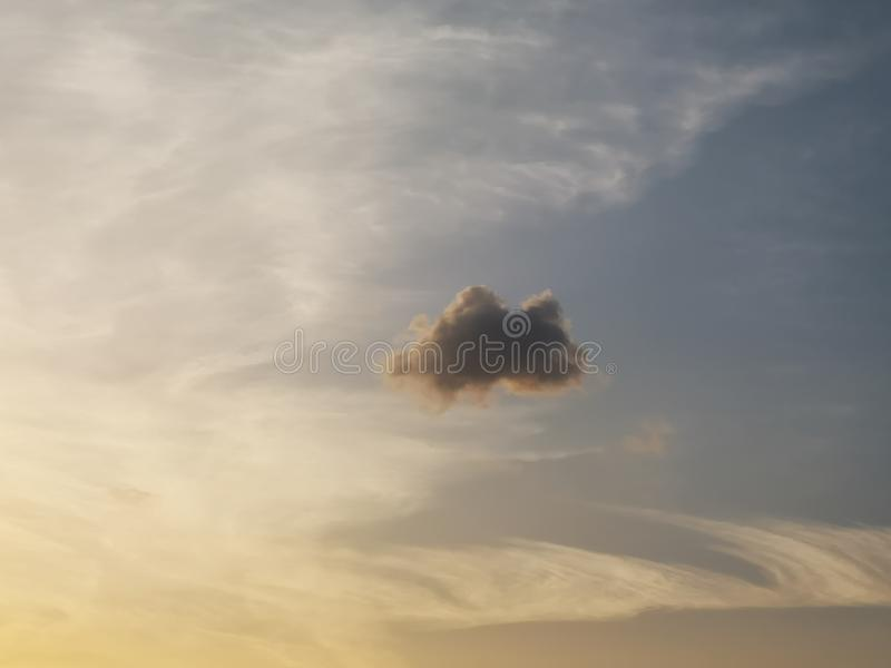 A strange cloud is floating In the sky. Lt is sunseting time.A strange cloud is floating In the sky.Its like a tortoise with black shell royalty free stock image
