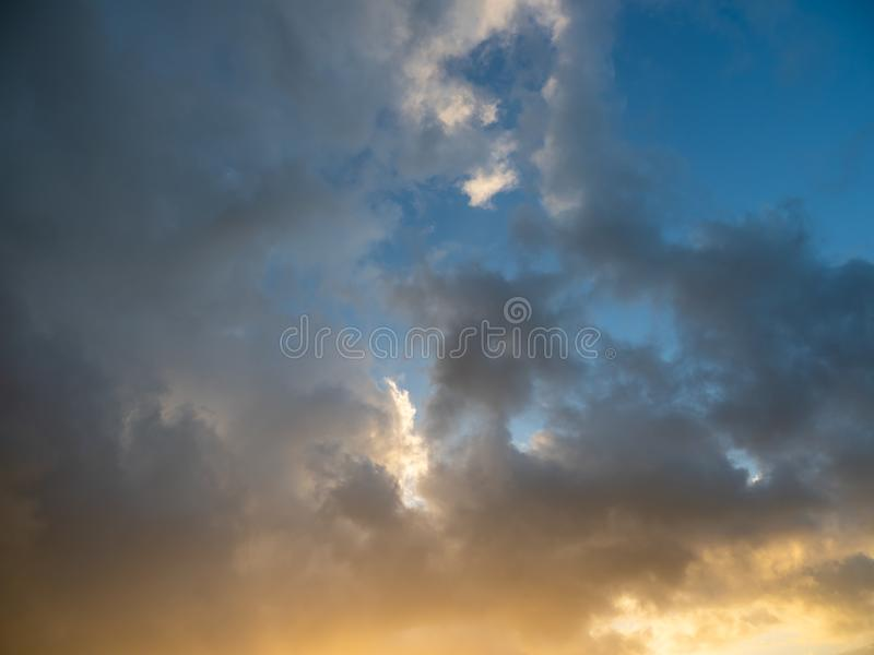 Strange clouds in the sky at sunset stock photo