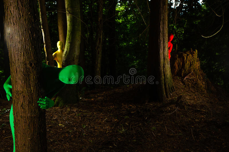 Strange colorful people in the forest stock images