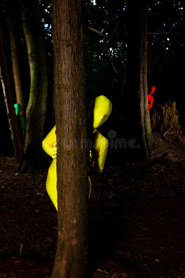Strange colorful people in the forest stock photography