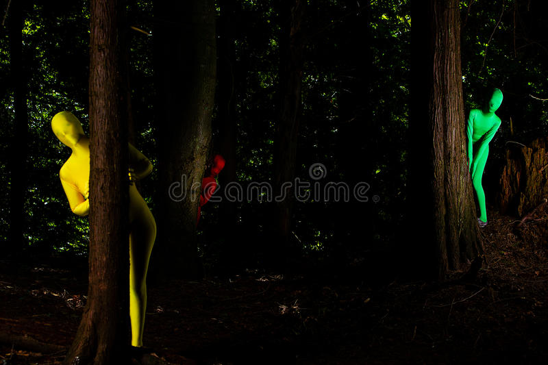 Strange colorful people in the forest royalty free stock photos