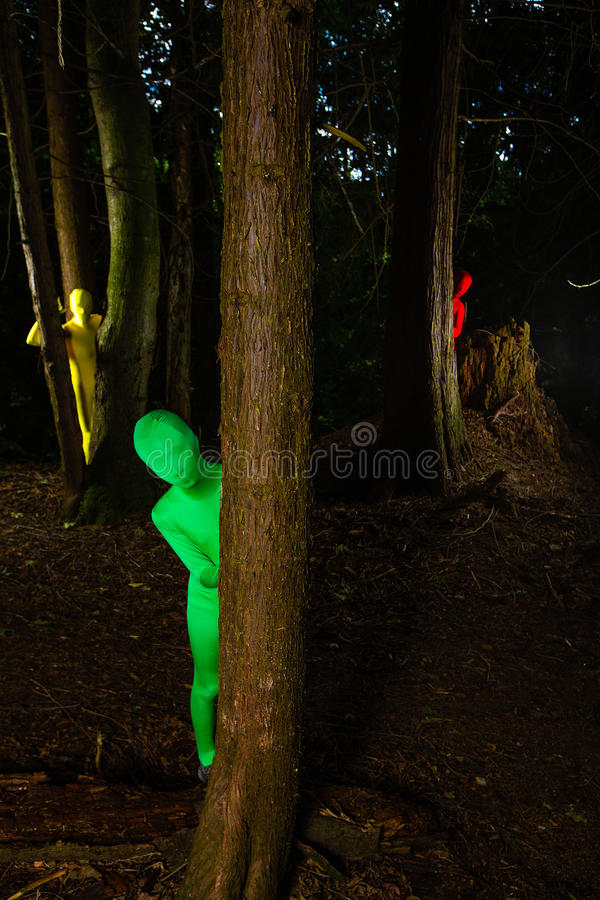 Strange colorful people in the forest stock photo