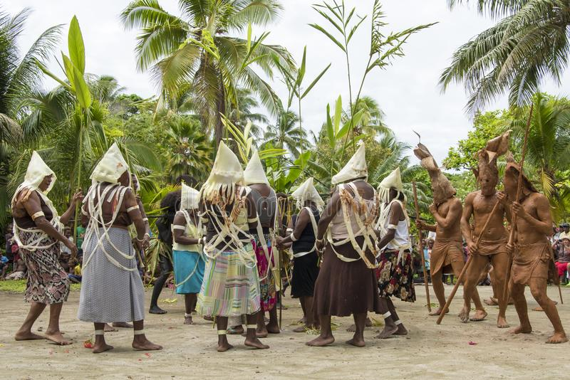 Strange dance ceremony with mud people, dancers Solomon Islands royalty free stock photography