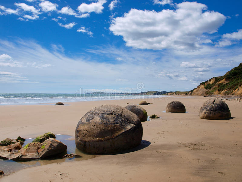 Strange geological phenomena moeraki boulders. Moeraki boulders, a strange geological phenomena at a sunny beach near Dunedin royalty free stock image
