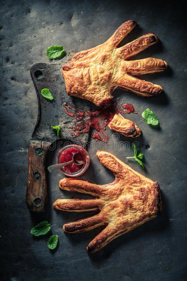 Strange hand cake with strawberry jam as concept of liking. On wooden table stock photo