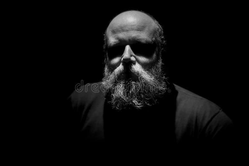 Strange man with eyes in shadow royalty free stock images
