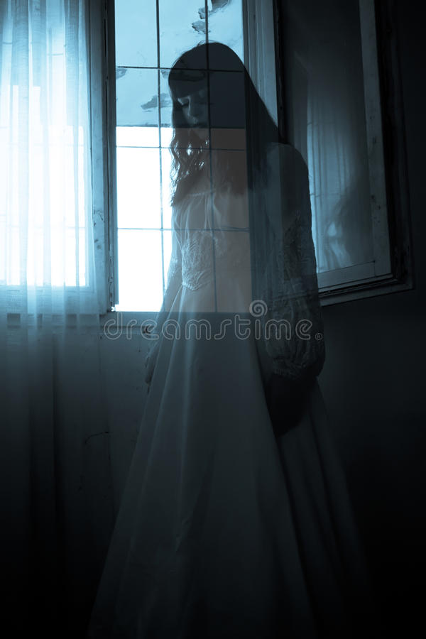 The strange mysterious girl. In white dress royalty free stock photos