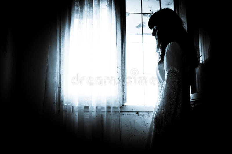 The strange mysterious girl. Horror scene of a scary woman royalty free stock photography