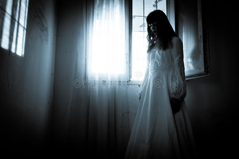 The strange mysterious girl. Horror scene of a scary woman stock image