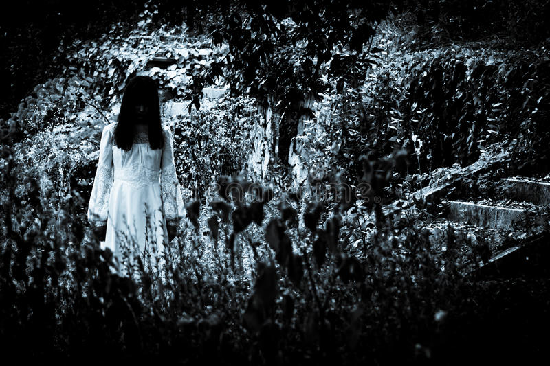 The strange mysterious girl. Horror scene of a scary woman royalty free stock photo