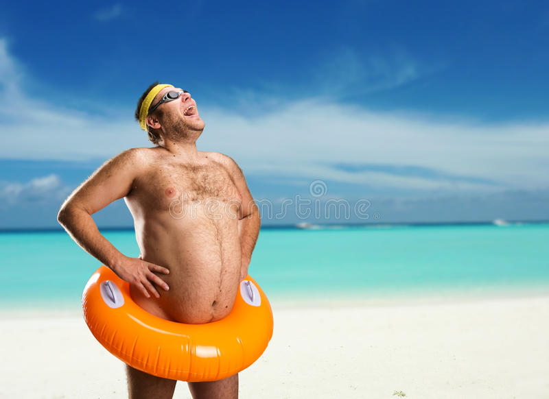 Strange naked man on the beach royalty free stock photography