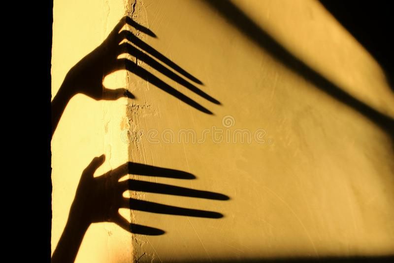 Strange Shadows On The Wall.Terrible Shadows. stock photos
