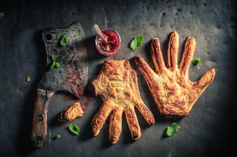 Strange two hands cake as concept of liking. On wooden table stock photography