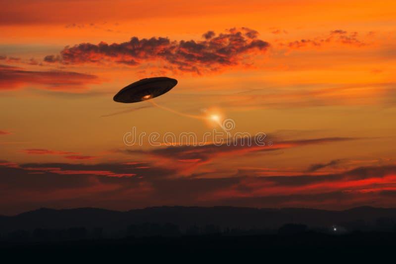 Strange UFO Activity. A multiple UFO sighting outside on a field stock photo