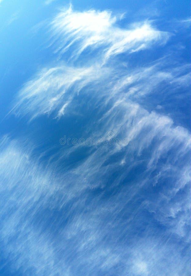 Strange white clouds on blue sky stock photos