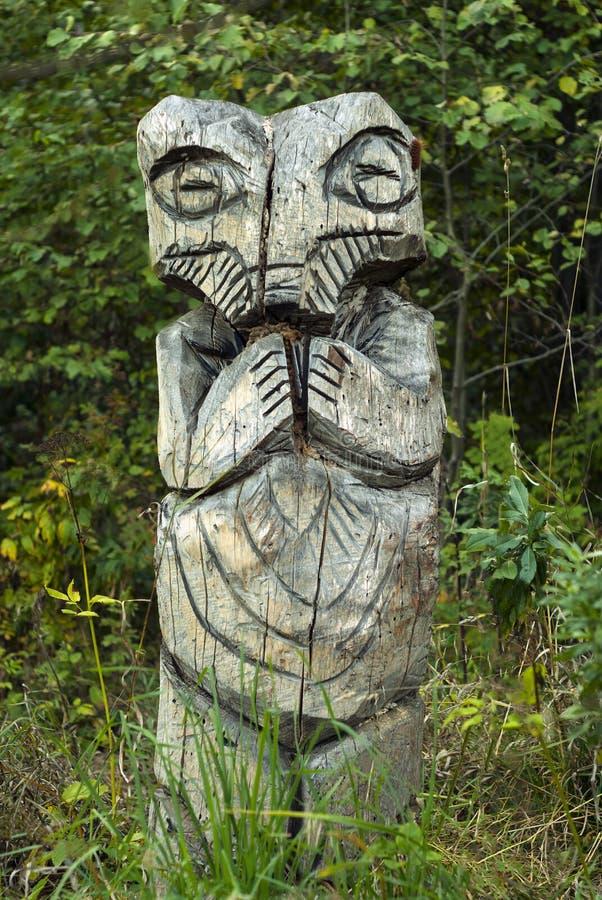 Strange wooden totem stock photos