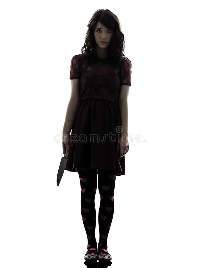 Strange young woman killer holding bloody knife silhouette stock image