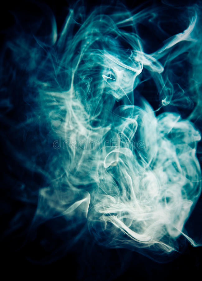 Strangely shaped puff of blue smoke royalty free stock photos