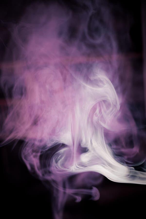 Strangely shaped puff of smoke stock photo