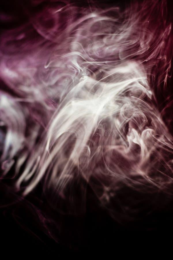 Strangely shaped puff of smoke stock photography