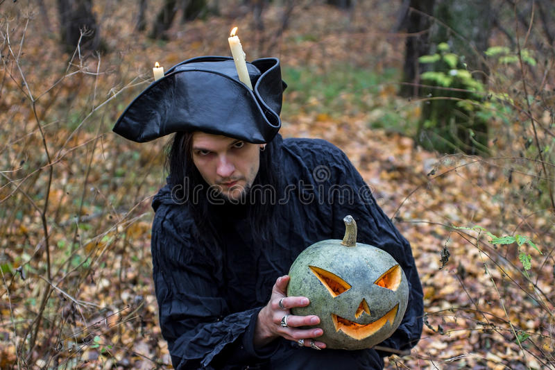 Stranger with covered face keeps pumpkin royalty free stock images