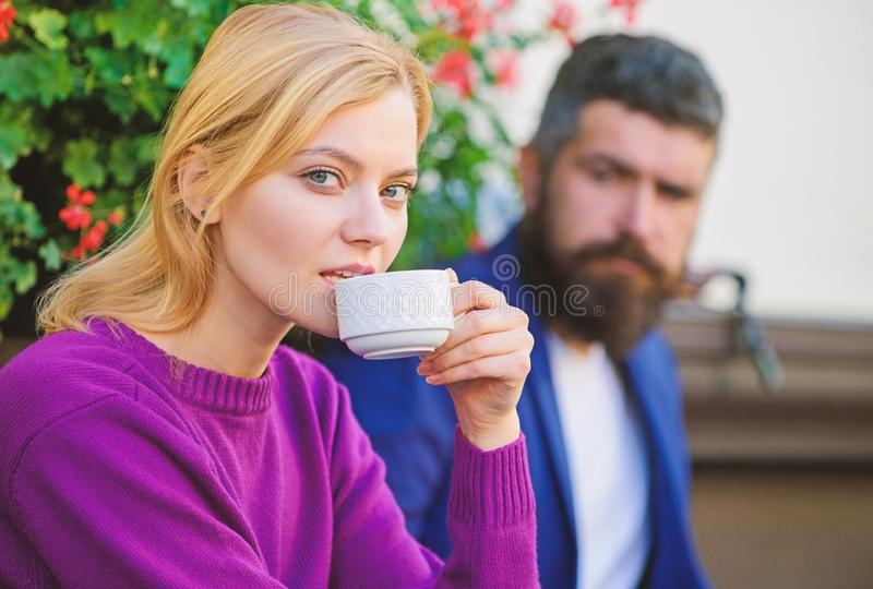 Strangers meet become acquaintances. Apps normal way to meet and connect with other single people. Meeting people first. Date. Couple terrace drinking coffee royalty free stock photos
