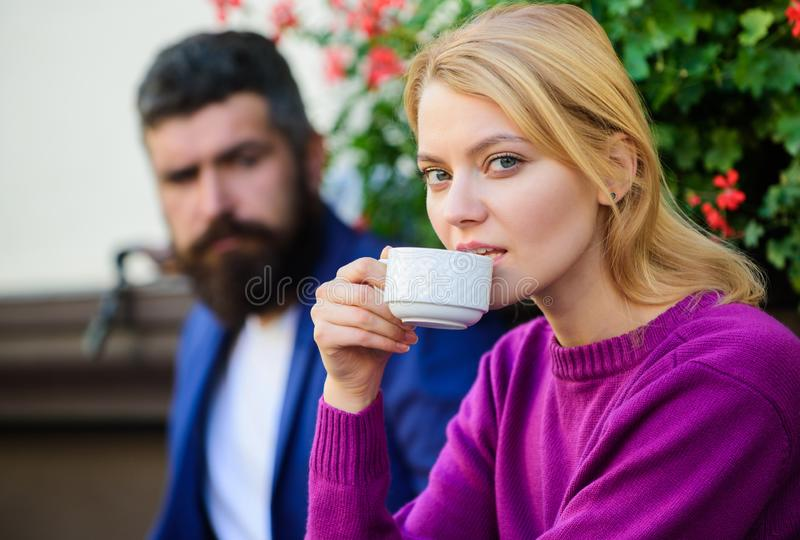 Strangers meet become acquaintances. Apps normal way to meet and connect with other single people. Meeting people first. Date. Couple terrace drinking coffee stock photo
