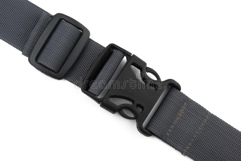 Strap. Locked black plastic buckle on strap isolated on white royalty free stock photo