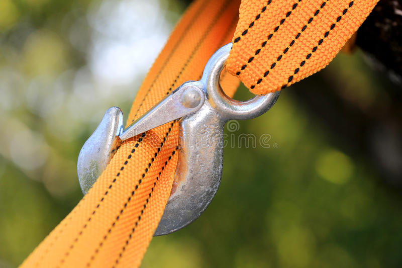 Strap and steel hook. Yellow strap and steel hook royalty free stock image