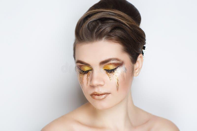 Strappi dorati della donna fotografie stock