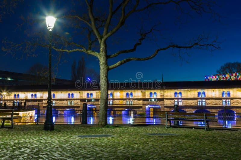 Strasbourg Barrage Vauban (Vauban weir). Illumined Barrage Vauban at twilight reflected in the waters of the River Ill, Alsace France royalty free stock photos