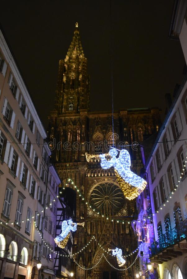 Strasbourg Cathedral with angel lights. Strasbourg Cathedral de Notre-Dame is known as one of the most beautiful gothic cathedrals in Europe stock photos