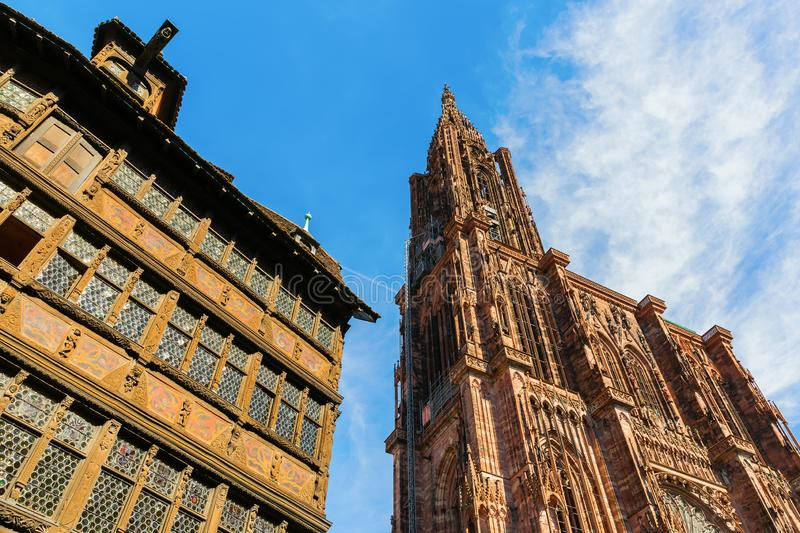 Strasbourg Cathedral beside a historical house stock photography